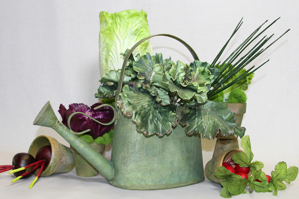 A grouping of artificial veggies simply set in mossy pots is an easy way to create a large arrangement.