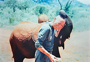 Orphaned elephant with Gary in Tsavo National Park, Kenya