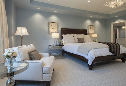 Beautifully decorated master bedroom with sitting area.