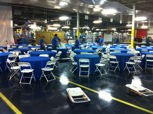 blue and white tables setup workers.jpg