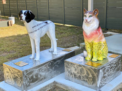 Beautiful dog and cat statues were created by artists Pook Bellini of LASS and Kristina Ray.