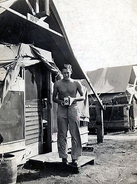 5. My dad with his camera outside of his tent at Hickam Field
