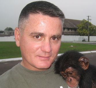 Anthony C. Fabiano in Africa with rescued chimp, Lucy