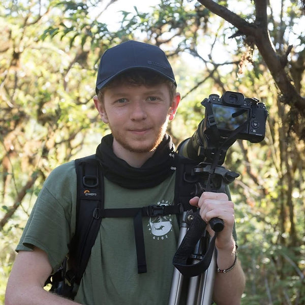 Ollie Smith filming in the Galapagos. Photo taken by Sophie Goodison. Wildlife Filmmaker and Photographer. Camera Operator.