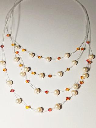 Collar perlas volando