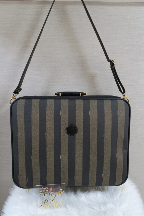 c6f9ac6a82af9 This vintage luggage features Fendis pequin stripe print on the outer with  a Fendi logo emblem on the front