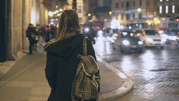 girl walking in dark.jpg