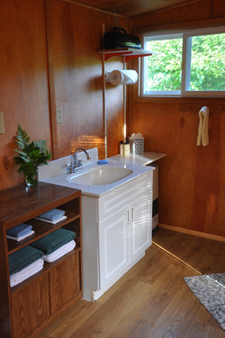 Bathroom located at back of Cabin.