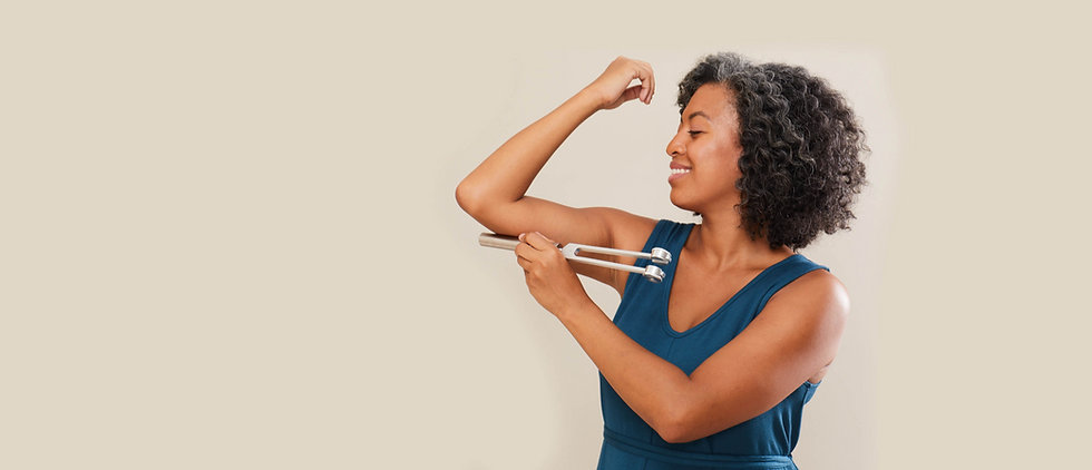 Woman using Sonic Slider Tuning Fork on her Arm