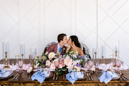 blue wedding tablescape with tall candle