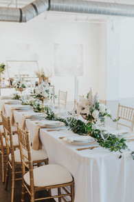 Art Gallery Wedding Reception Table with Gold Decor