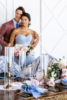 tall candles with vases