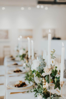 Reception Table with Taper Candles and Gold Accents