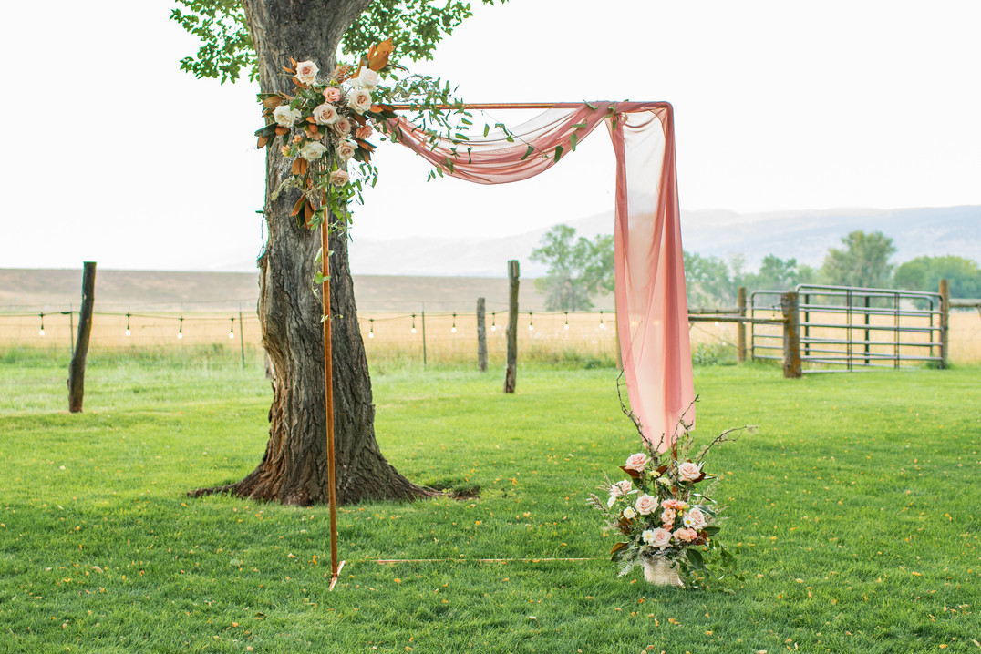 Copper Arch with Pink Draping and Flower