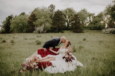 red burgundy loveseat bridal shoot.jpg