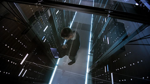 it-engineer-working-with-laptop-in-data-