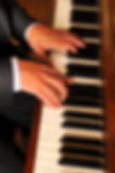 Gordon's hands on piano.JPG