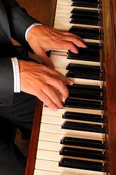 Gordon's hands on piano.JPG
