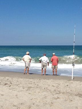 3 men surf fishing