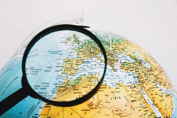magnifying-glass-near-globe small.jpg