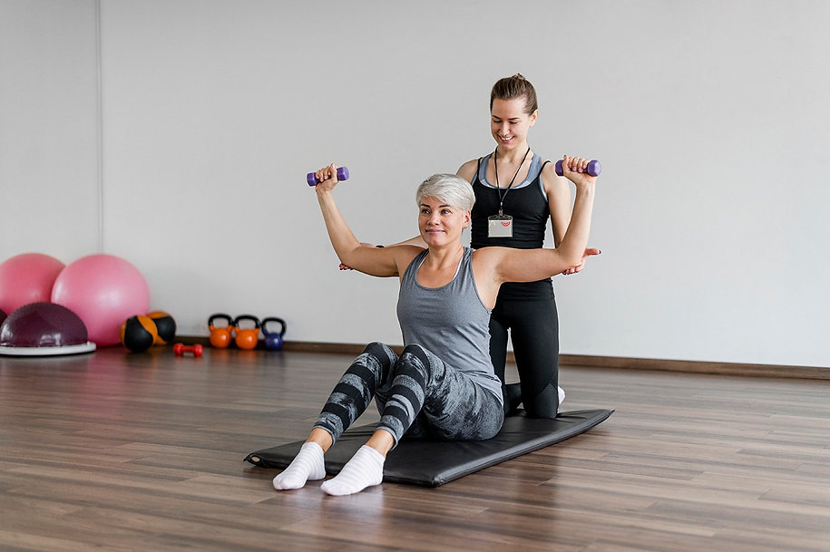 workout-with-personal-trainer-arm-exerci