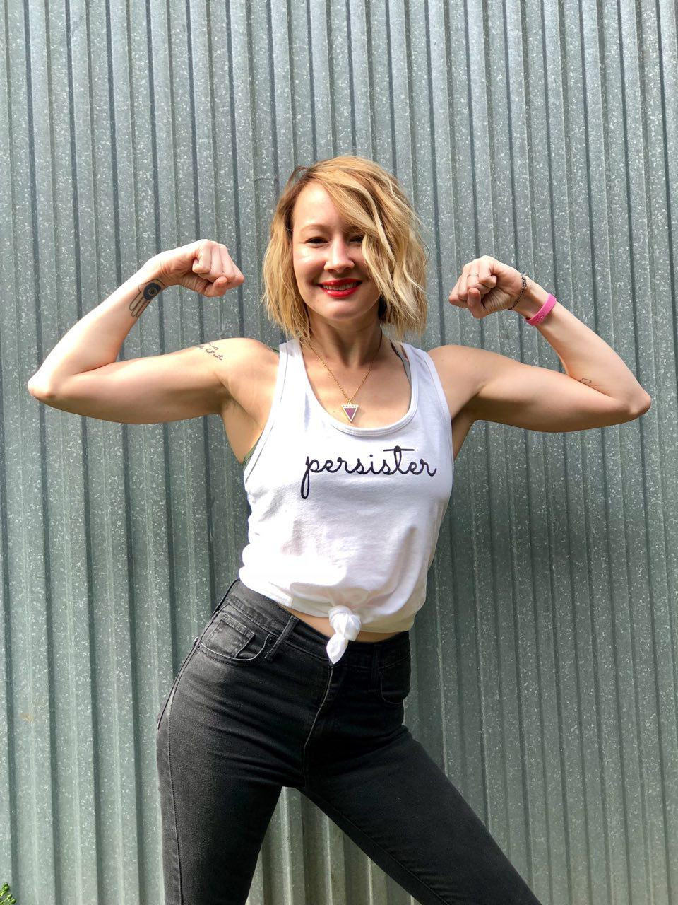 Christalle flexing and wearing Persister tank