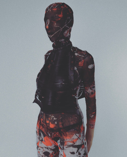 Model Llily Prentice wears the BIA printed powermesh catsuit with mask in and the ASTRAEA slashed top in black PVC  Styled by Charlotte Wilcock Photographed by Abdullah Yahia