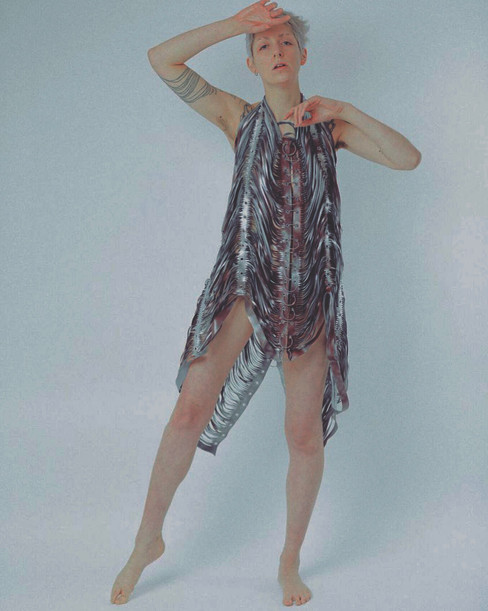 Model Llily Prentice wears the LACHESIS slashed body covering hand painted silver in burgundy PVC Styled by Charlotte Wilcock Photographed by Abdullah Yahia