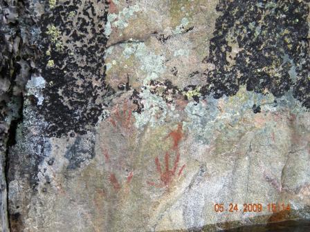 A hand among some symbols.