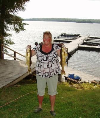 Daughter Lori caught some fish (and sun) as well.