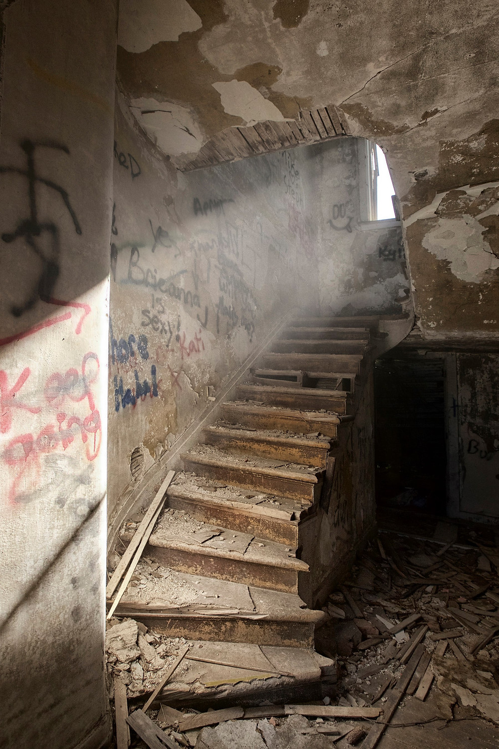 Abandoned stairs dust in light beam