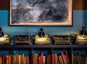 vintage typewriters on bookshelf.jpg