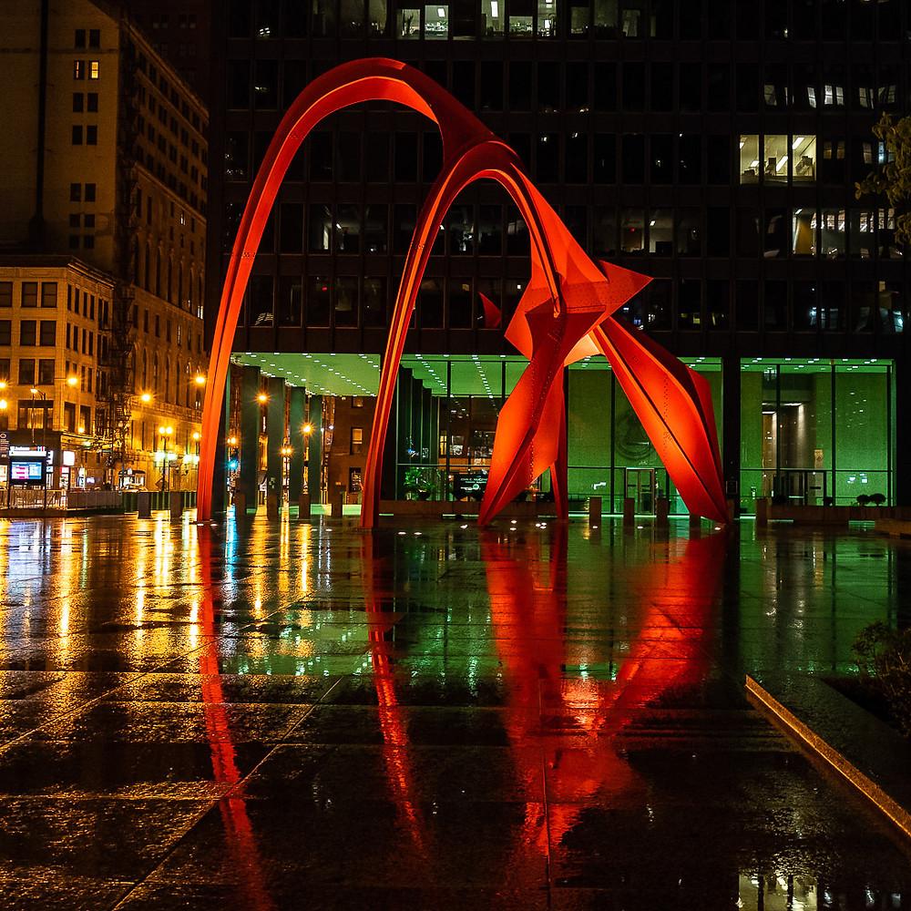 Calder's Flamingo sculpture in Chicago reflections rain wet