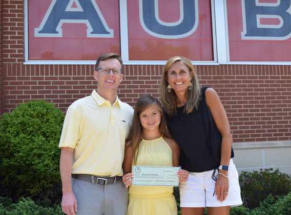 Grace with her parents