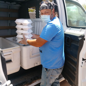 Carl (HR Driver) loading lunches