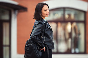 Young fashion woman with backpack walkin