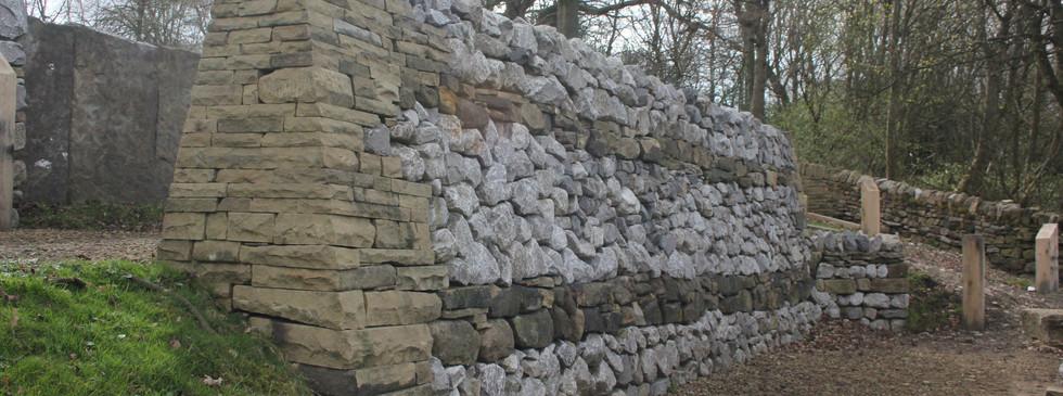 Mixed limestone and sandstone wall.JPG