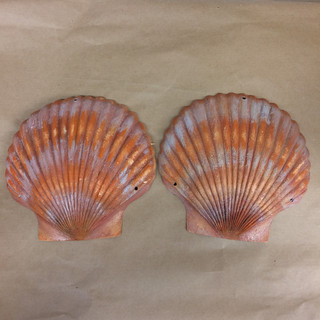 Plastic sea shells painted to look realistic and then later on exaggerated to accentuate the bold scene.