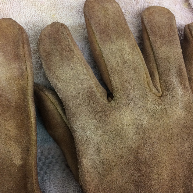 I dyed leather gloves in order to darken them to the earthy color palette of the show. I distressed the gloves in order to show normal wear from working all day, every day.