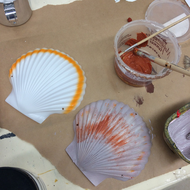 Plastic sea shells painted to look realistic and then later on exaggerated to accentuate the bold s