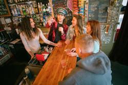 Enjoy a stroll down Creek Street during the Ketchikan Pub Crawl tour