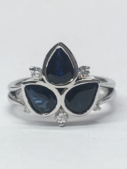 Remodeled 18ct white gold sapphire and diamond ring.