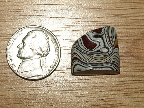 Fordite Cabochon with Red Pit