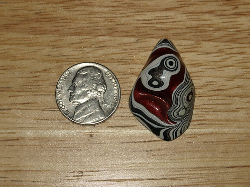 Fordite Cabochon with Red Craters