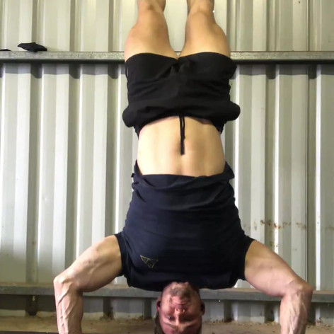 Hanstand pushups - 8 sets minimum