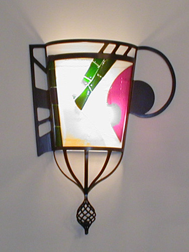 Fused wall sconce in custom built wrought iron support
