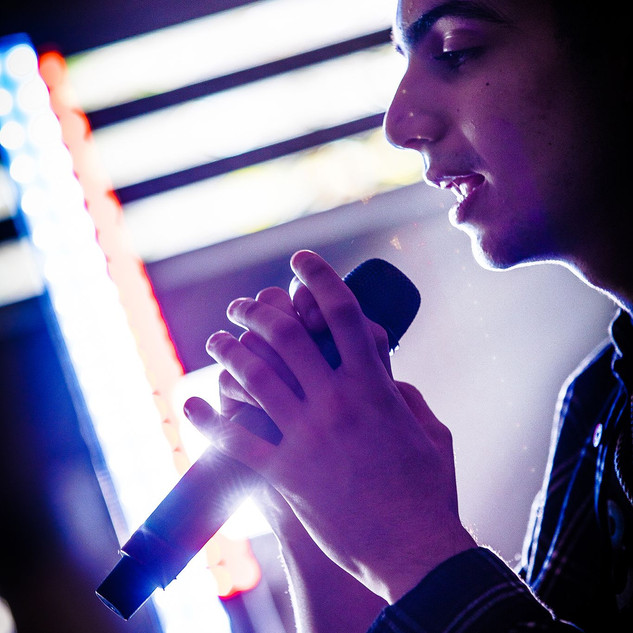 omar singing.jpeg