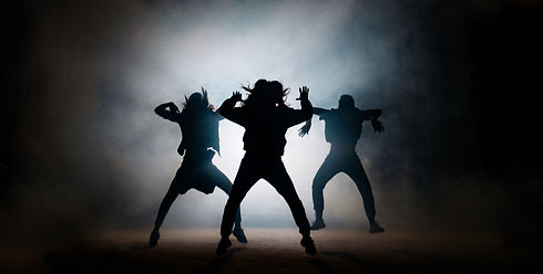 Group of young hip-hop dancers performin