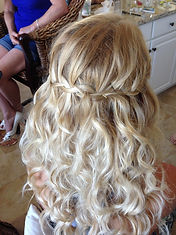 Waterfall braided wedding hair with soft, cascading curls