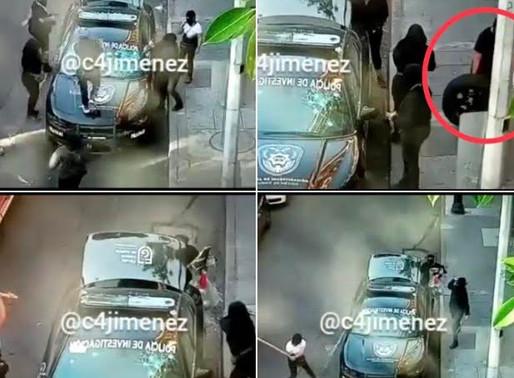 Encapuchadas destrozan patrulla de PDI...  le roban hasta la llanta